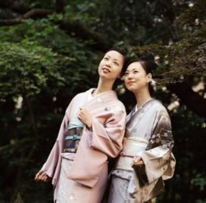 Two Women Wearing a Kimono Looking up